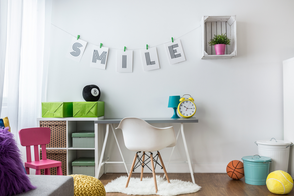 Positive bright teenager room idea with space to learn